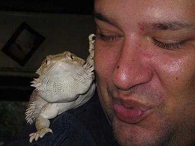 David Hammond and bearded dragon Romeo having cuddles